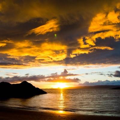 Sunset seen whilst sea kayaking on the Scottish sea kayak trail.