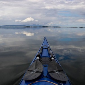 Kayaking through calm seas on the way out to the Arisaig Skerries.