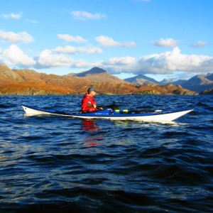 Sea kayaking with the mountains of Knoydart as a backdrop.