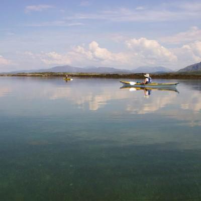 Sea kayaking through calm water near Arisaig on the Scottish sea kayak trail.