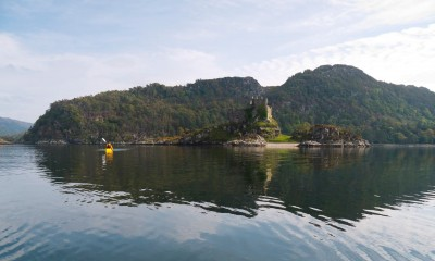Sea kayaking past Castle tioram in Loch Moidart.
