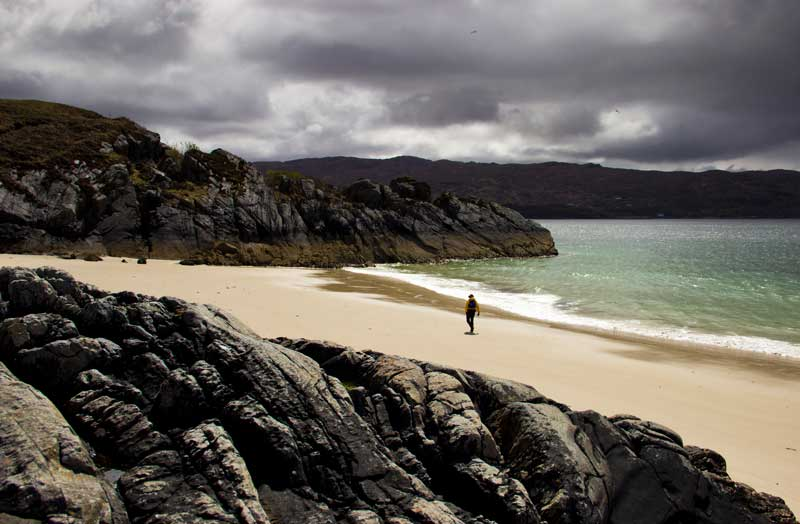 A sea kayaker on a remote back near Glenuig
